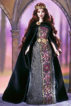 Princess of Ireland™ Barbie® Doll  Barbie® doll looks sensational as a Celtic princess in an olive green gown with detailing inspired by the artwork of the Celtic people. She wears a forest-green cape adorned with a golden brooch reminiscent of the legendary Tara Brooch of the ancient Celts. The final regal touch is a lovely golden crown that rests atop her long red wavy hair.