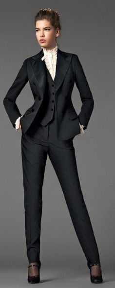 Work outfit inspiration. While a tad formal for my office (we are business casual, not business formal), I love the structure/fitted look of this suit. I like the look of a fitted vest over a crisp white button-blouse.