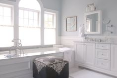 Suzie: Mabley Handler - Chic bathroom with pale blue walls paint color, white medicine cabinet, ...