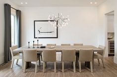 Elegant pendant adds beauty and contrast to the contemporary dining room [From: Maxine Schnitzer Photography]