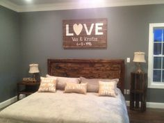 Rustic wood platform bed and end table crates from James+James with barn wood sign.