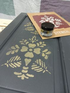 Annie Sloan Petrushka stencil in gilding wax over Graphite dry brushed with Chateau Grey.