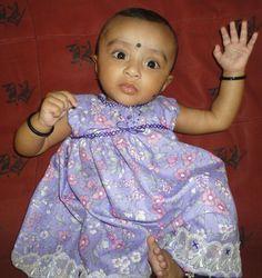 baby girl in handmade frock