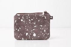 White splatter design decorated coin purse.