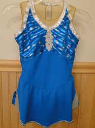 Sk8 Gr8 Designs. Custom Competition Figure Skating Dress. Gorgeous Swarovski rhinestones crystals in Blue Zircon and Crystal AB on a gorgeous unique turquoise fabric. www.sk8gr8designs.com