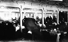In spite of the damage to this photograph, still fascinating to see Titanic's passengers enjoying themselves, little knowing what was soon to come.