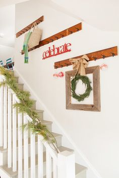 Not a bad idea for decorating changes on a staircase or for hanging things that need to be taken bath and forth between floors