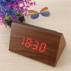 Handmade Classic Triangular Blue Digital LED Wood Wooden Desk Alarm Clock Thermometer by Mahrezco on Etsy https://www.etsy.com/listing/497783327/handmade-classic-triangular-blue-digital