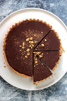 Salted Caramel Snickers Tart {vegan, refined sugar free, healthy, whole foods} Peanutty crust, caramel filling studded with roasted peanuts and a creamy chocolate topping - Healthy 'n Happy