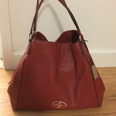 Coach Edie Pebble Shoulder bag Beautiful authentic Coach shoulder bag in new condition. Leather is pebbled and a rich red. This has been worn only once and is in mint condition. No visible flaws. Coach Bags Shoulder Bags