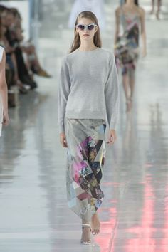 Preen, London Fashion Week 2014. The collection pulled from the bet of American sportswear – a gray sweatshirt topping a sheer skirt with fluidity.