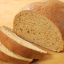 RUSSIAN RYE BREAD  1 1/4 cups lukewarm water (105°F to 115°F)  2 T barley malt extract or dark honey  2 t instant yeast  1 1/2 cups medium rye flour or pumpernickel  2 t salt  1 T caraway seeds  3 T unsalted butter, melted  3 cups King Arthur Unbleached All-Purpose Flour