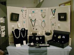 jewelry display booth - Use PVC and cover in fabric to remove the distracting background.