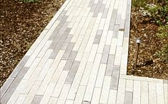 Narrow modular pavers from Stepstone Inc.  Would love for the backyard.