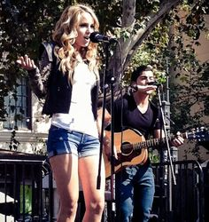 Bridgit Mendler jams live at The Grove. Love her early fall look - cuffed jean shorts, plain white tee and a statement-making embellished jacket.