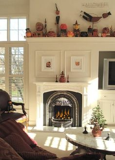 Great way to combine and fireplace and tv on the same wall - keep the 2 focal points on the same wall for arranging furniture and seating - without putting the tv above the fireplace. Also great Halloween decorating ideas for the fireplace.