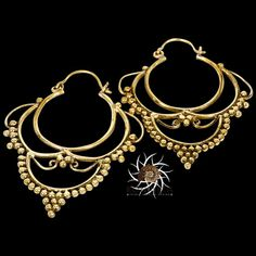 Brass Earrings - Brass Hoops - Ethnic Hoops - Gypsy Hoops - Hoops Jewelry - Brass Jewelry - Ethnic Jewelry - Ethnic Earrings New in my brass collection, a beautiful brass earring with a tiney balls work. You will be seen immediately with this statement earrings. Diameter: 45 mm Weight: 3.5 gram. Bar thickness: 0.9mm Nickel Free! Sold as pair only! $22