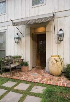 front entrance idea -expand entryway and cover with pavers to make room for bench?