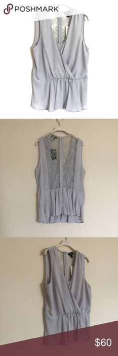 """Nicole Miller silver lace peplum blouse NWT L New with tags. Style: Silver Zepplin. Draping front with peplum skirt. Lace back with zipper. Color has a light blue tint. Pit to pit 20"""", length 25"""". 100% polyester. Nicole by Nicole Miller Tops"""