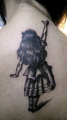 alice tattoo.....i like the style of this tattoo