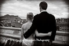 Dramatic stuff. A black & white view of Edinburgh and a married couple staring over the city from this exclusive vantage point on the roof of The Balmoral Hotel.