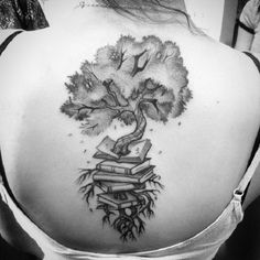 The black and white Tree growing from Books. This tree growing from within the stack of books is another amazing worth trying book tattoo design for all the tattoo lovers out there.