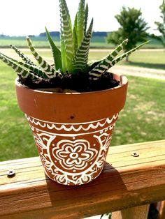 "Terracotta Baked Earth Hand Painted Mandala The by GypsyDarlingCo ""The Wanderer"" This Hand-painted Mandala Terra cotta Planter Pot was inspired by the unconventional lifestyle that of the Traveler. It brings a small piece of wander, adventure, and inspiration into your personal space. #terracotta #amazonianclay #boho #wander #travel #wanderlust #painter #potpainting #custom #handpainted #lifestyle #mandala #adventure #inspiration #travel"
