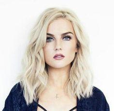 Longer mid length hair. Platinum blonde