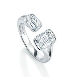 A beautiful, classic diamond ring from Boodles' Pas de Deux collection, inspired by and in collaboration with The Royal Ballet. Set obliquely with two Ashoka cut diamonds weighing 2.20cts in platinum.