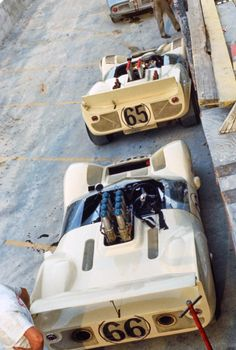 In the Oakes Field pits at Nassau, the Chaparral 2C (#66) and the Chaparral 2 await practice to begin. Eric della Faille photo, restored.