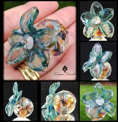 Lorraine Dowdle - Large bauble lampwork bead filled with butterfly and rose murrine, silver mesh and more, heavily encased in crystal zhepyr and accented with a sculptural flower ( 36mm petal span) <3