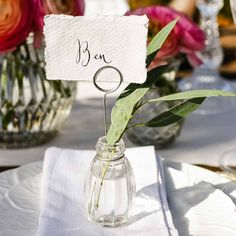 Looking for wedding place card holders? Our Glass Bud Vase Name Card Holders will add that something unique to your wedding table decorations - add a tiny flower to the place card holders. Wedding Vases, Wedding Table Decorations, Wedding Table Settings, Wedding Favours, Place Settings, Name Card Holder, Place Card Holders, Diy Save The Dates, Wedding Name Cards