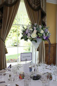 Purple wedding flower centrepieces by flourish to hire silk flowers Devon and Cornwall