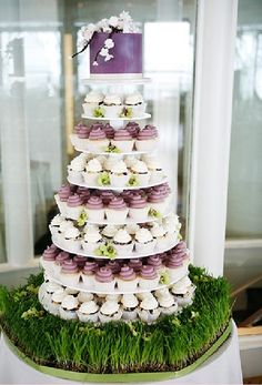 small cake with 7 tiers of cupcakes. Maybe do the bottom tier in cake so u can save the top tier  for our anniversary