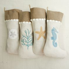 Stockings in burlap & linen with sea horses & sea plants from Wistaria are trimmed with mother of pearl buttons.