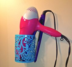 I was looking for a more elegant way to keep my blow dryer & straightener out and easily accessible, so when I found this inexpensive metal candle holder at Target, something clicked! I grabbed a can of spray paint to match my bathroom decor, & simply mounted it to the wall with a screw anchor & screw. Inexpensive, sturdy, heat resistant, & cute...LOVE it!
