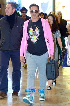 "arrives in China for the second leg of his international ""Iron Man press tour. 5 April With his fashion sense fully locked in. Only he would het away with pink! Sherlock Holmes Robert Downey, Robert Downey Jr., Avengers Shirt, Avengers Cast, Iron Man 3, Super Secret, Press Tour, Downey Junior, Tony Stark"