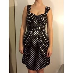 Pink and black polka dot dress Very silky and figure flattering. One of my favorite dresses! Size says 3 on the dress but fits like a 2 Teeze me  Dresses