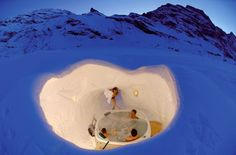 Engelberg-Titlis Igloo Village, Engelberg, Switzerland with a cheese fondu meal and a soak in the Jacuzzi.  sold!