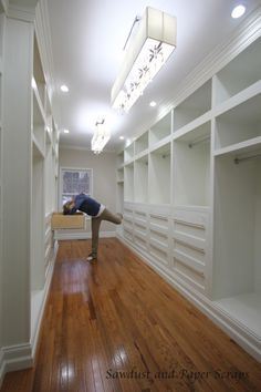 Now this is a closet!!!! Wow!  It even has large soft/self closing drawers!  I cannot wait to see her 9'x6' shoe cabinet! I wonder if I could get her to build mine! :D