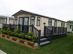 Caravan Makeover 436708495111684796 - Gayle grey and driftwood Fensys decking at the Lawns holiday home caravan show Source by suzannegarland