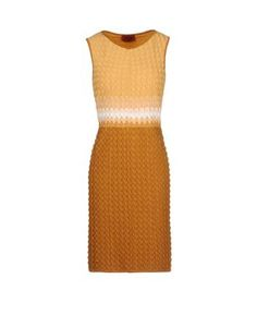 Sleeveless V-neck dress in knitted lace with 3-D stitching.