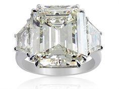 Alson Signature Collection Platinum Three-Stone Engagement Ring, Featuring a 9.90 Carat Emerald Cut Diamond, H Color, VS2 Clarity, EGL Certified, Accented with 2 Trapezoid Diamonds =1.55cts Total Weight