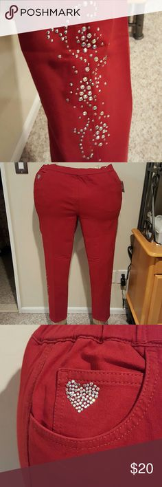Quacker Factory rhinestone embellished Red Jeans Cotton spandex blend 3 pocket knit jeans. Jeans are pull on have a faux fly. There is a rhinestone heart on the coin pocket and rhinestone designs on the sides of the legs. Inseam 29.5 inches brand new with tags and never worn. Quacker Factory Pants Straight Leg