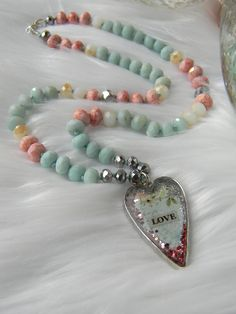 Love   By:  Fire-Imp Lampwork Beads  Sparkly Boho Glam meets Shabby Chic Romantic in the gorgeous heart necklace.