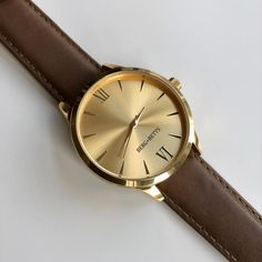 Sustainable and ethically made gold watch with mirrored gold face and a brown leather band made from leather that would have otherwise gone to waste. Leather Scraps, Gold Face, Watch Faces, Timeless Classic, Stainless Steel Case, Brown Leather, Quartz, Mindfulness, Watches
