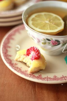 Lemon curd & raspberry tea biscuits with Tea. Drinking Tea:    Do not use your tea to wash down food. Sip, don't slurp, your tea and swallow before eating.