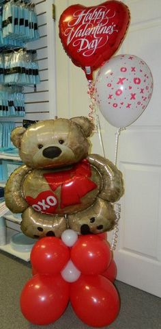 Valentine XOXO Bear holding balloons.  www.itspartytimeandrentals.com