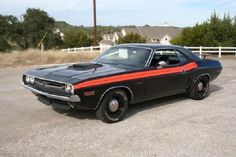 This 1971 Challenger R/T 440 six-pack is the only known car finished in TX9 Black Velvet with a V6V Orange R/T stripe.