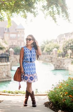 cute & little blog   petite fashion   blue vintage tile print dress, ariat heritage x cowboy boots, fringe bucket bag, statement earrings   summer fall transition outfit